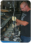 Handles, stationary bars, swing arms and other hardware components are built on subassembly lines