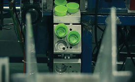 Conveyor Puts a Lid on Bottle-Cap-Assembly Problems
