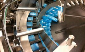 Centrifugal System Feeds, Orients Deodorant Containers
