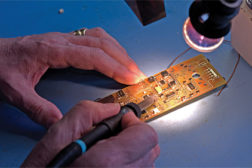 electronics hands working joining fastening